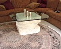 Glass top table with stone pedestal base