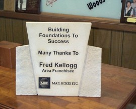 Custom stone award engraved for MBE Kellogg