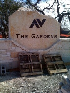This shows vinyl letters applied to the stone so the decision makers will have a visual of what the finished sign will look like. Based on this visual representation the final size of the letters was determined.