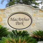 This is the MacArthur Park sign installed with the landscaping in place. The entrance features one on either side of the street.