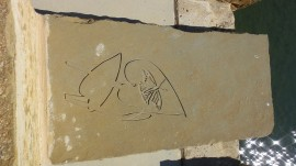 Now we feature plant life and a butterfly perched onto a leaf. This is engraved onto the limestone slab rather than the cement of the bridge